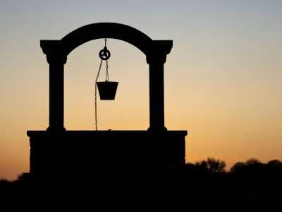 silhouette of a well